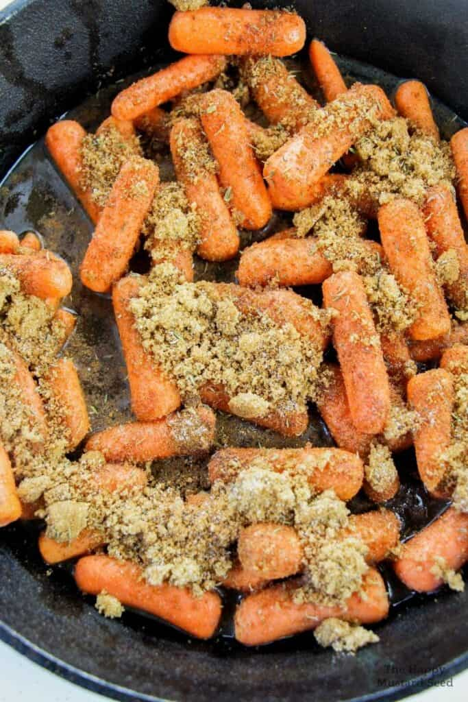 Carrots and brown sugar in pan for candied carrots recipe