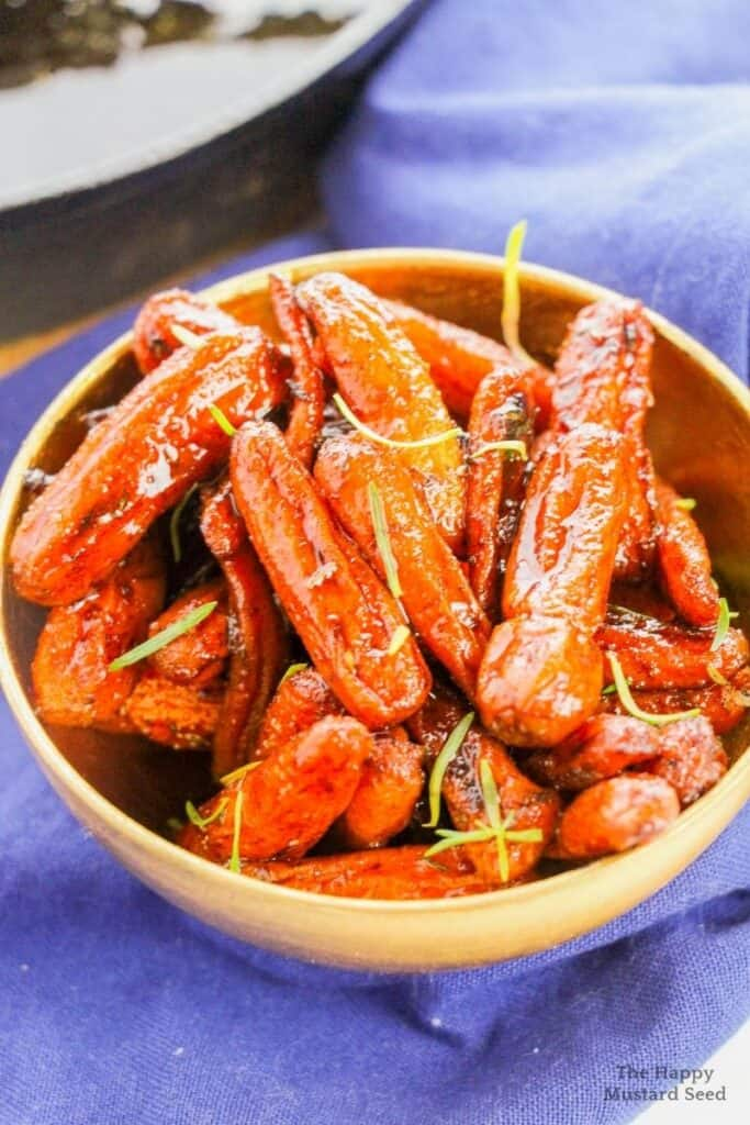 Old fashioned candied carrots in bowl