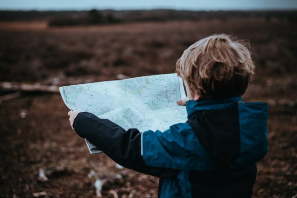 kid holding map