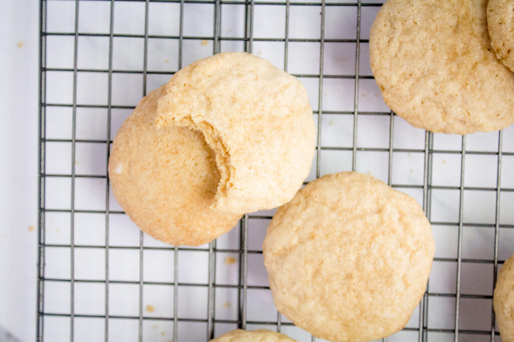 Sourdough Sugar Cookie Recipe with bit out of cooking on wire cooling rack