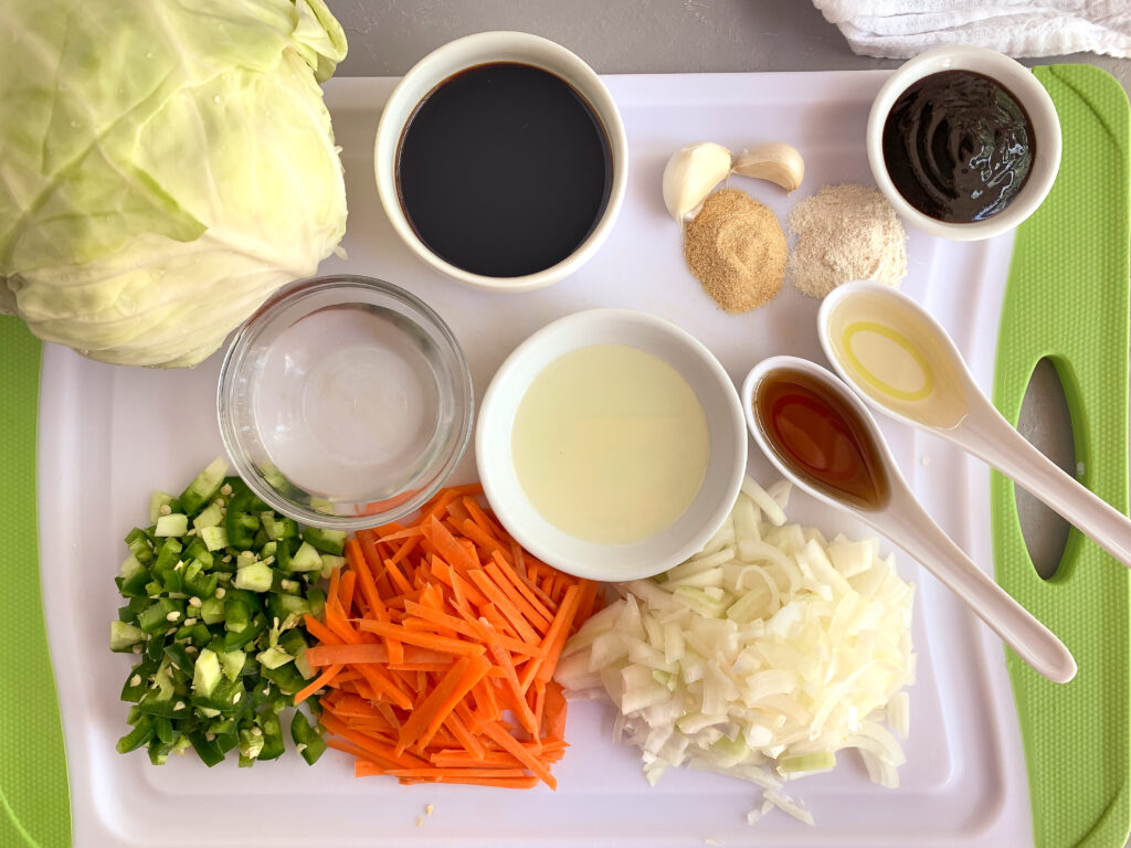 Ingredients for egg roll in a bowl on cutting board