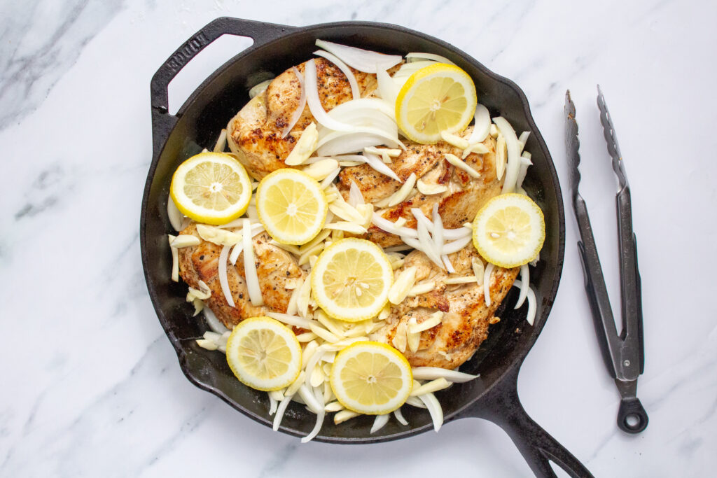 20 clove garlic chicken in a pan before cooking