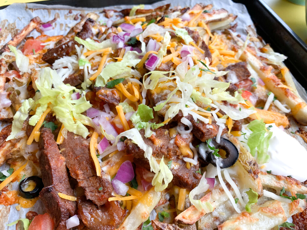 close view of sheet pan fries with toppings