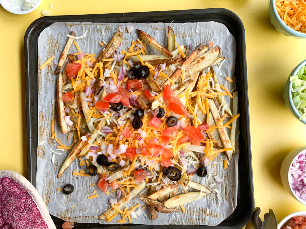 air fryer fries with melted cheese and tomatoes