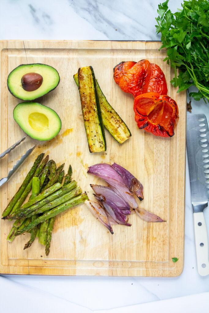grilled veggies on a cutting board