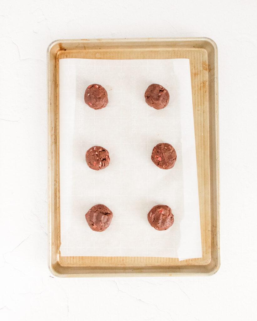balls-of-dough-on-a-cookie-sheet