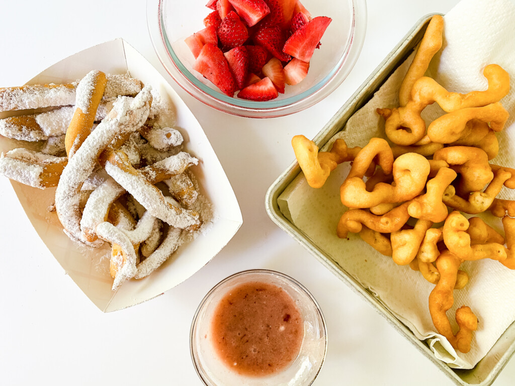 top view of funnel cake fries with sliced stawberries