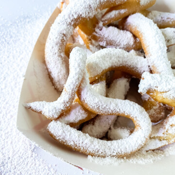 top view of funnel cake fries with powdered sugar