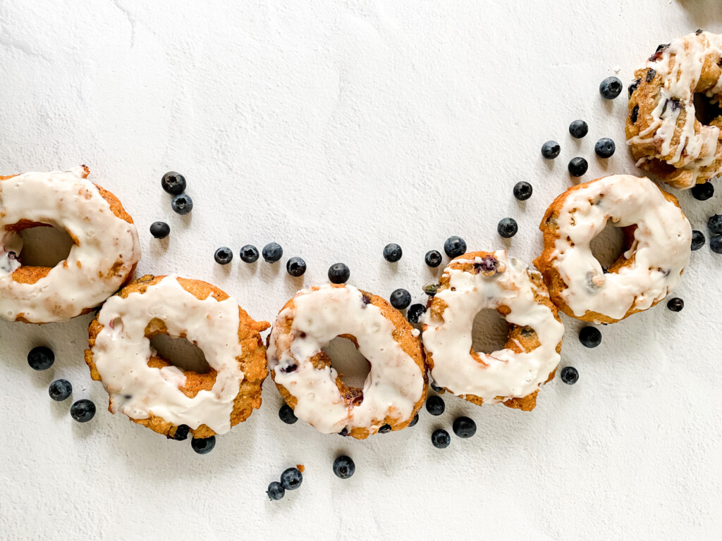 line of sourdough donuts with blueberries and glaze