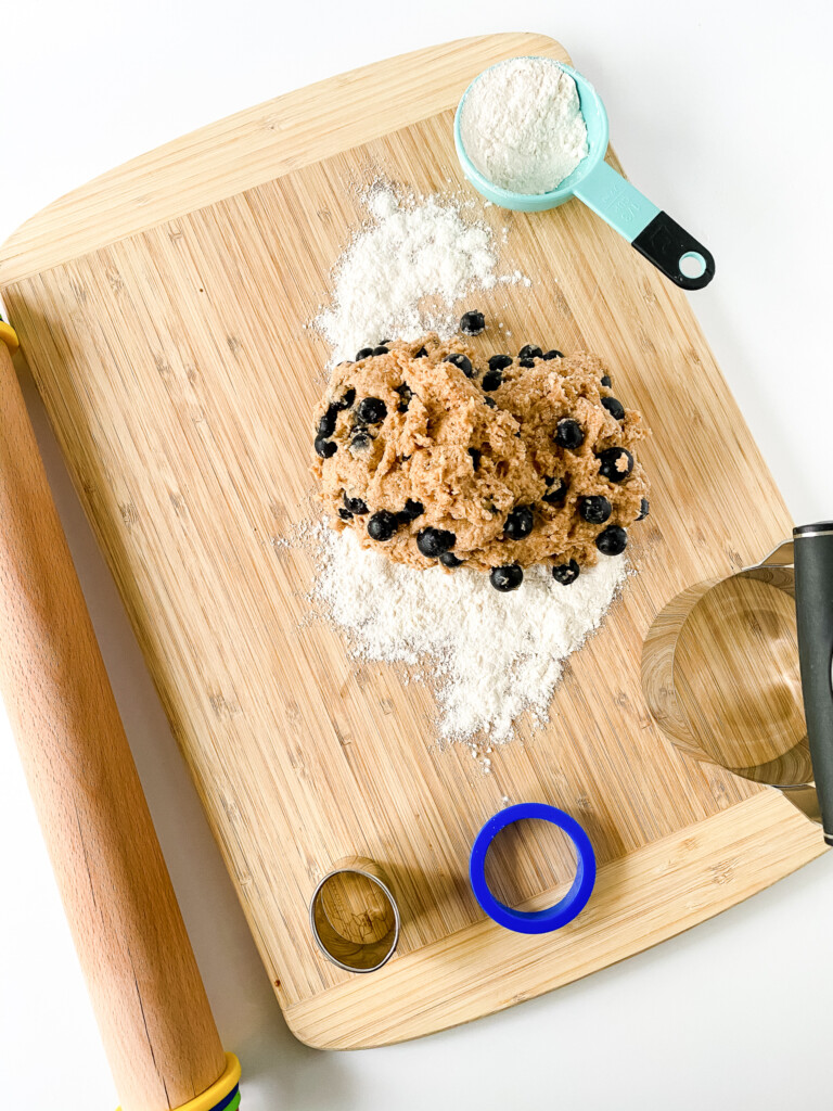 top view of dough with blueberries and flour