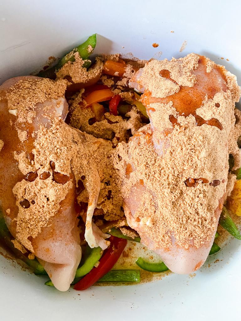 seasoning on Crockpot chicken fajitas
