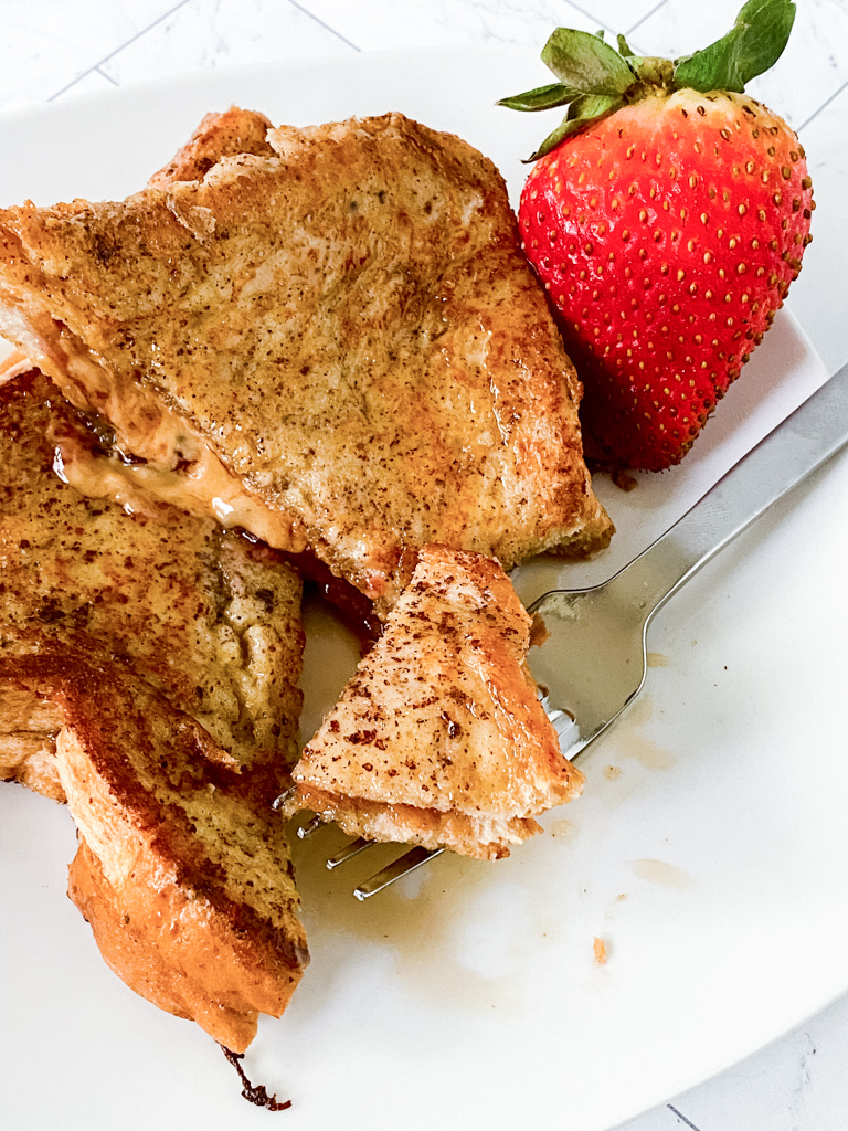 Double-Dip-French-Toast-Recipe on plate with strawberry