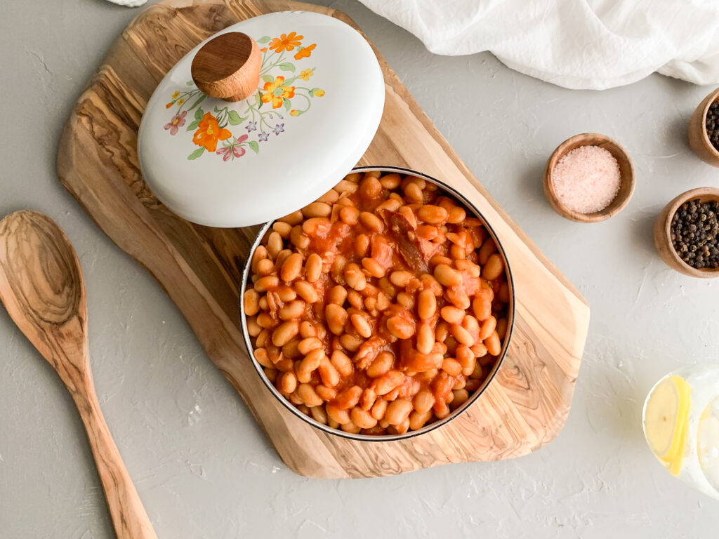 Pork-And-Beans-in-pan-next-to-wooden-spoon
