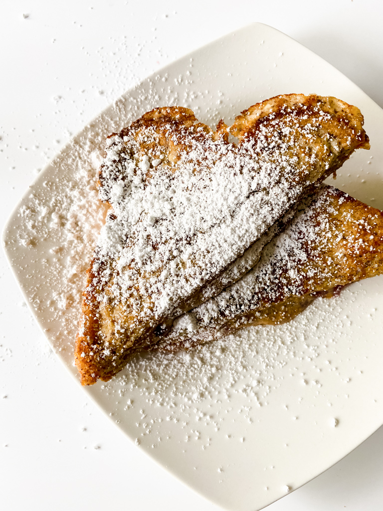 French-toast-peanut-butter-and-jelly-sandwich sprinkled with powdered sugar