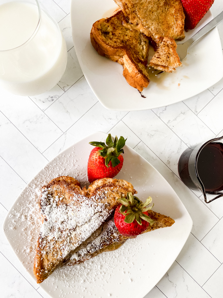 Double-Dip-French-Toast-Recipe with strawberries on white plate