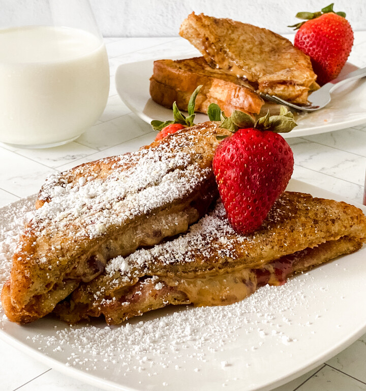 Double-Dip-French-Toast-Recipe with strawberry on white plate