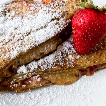 Double-Dip-French-Toast-Recipe on white plate with sugar