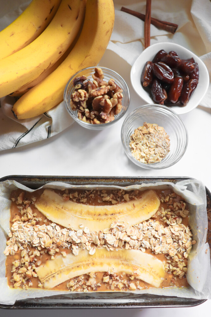 oats, banana, and sourdough banana bread batter in bread pan