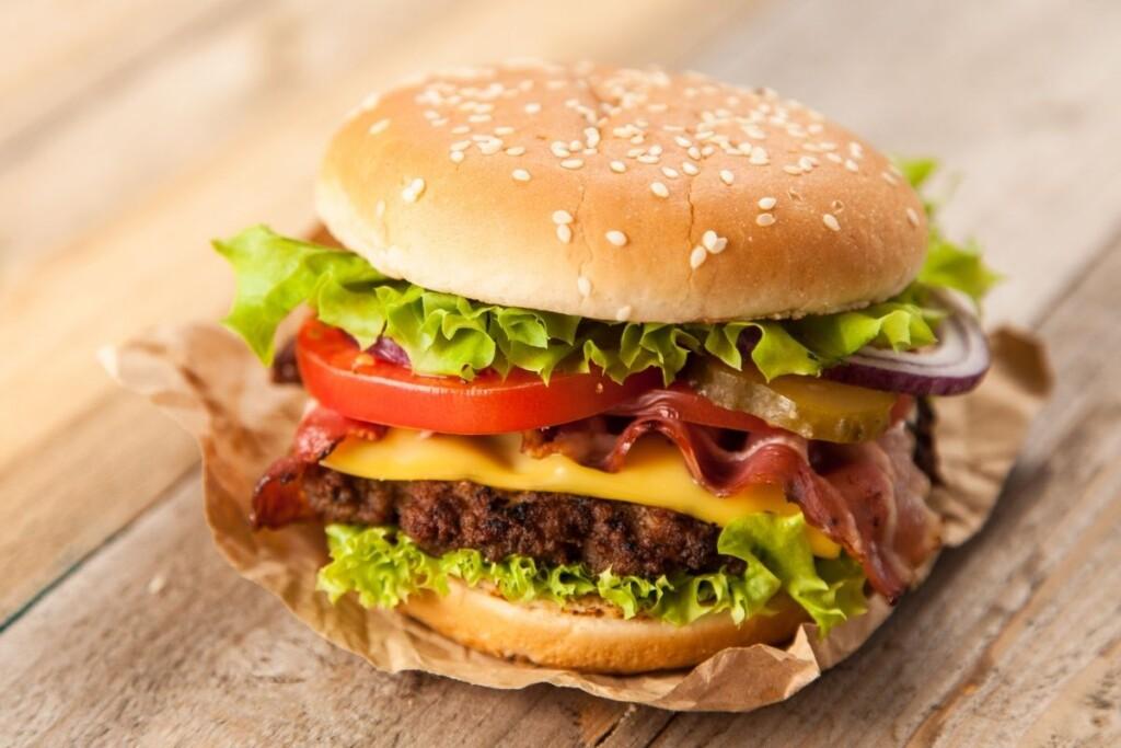 Hamburger-seeded bun-lettuce-tomato-cheese
